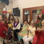 The residents enjoying the company of the hula dancers.